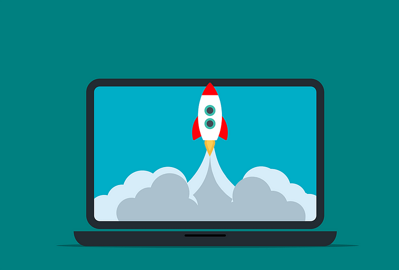laptop screen with a rocket taking off on the screen